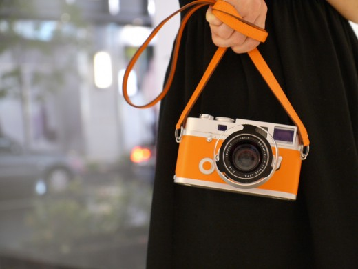 Leica Hermes orange held